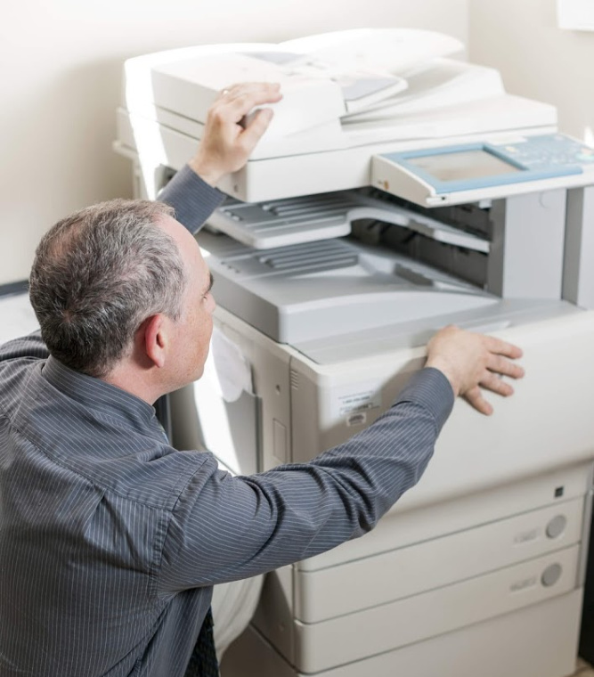 copier-machine-getting-fixed