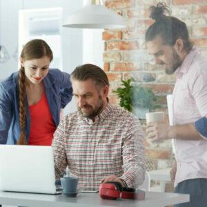 three-people-looking-laptop-screen