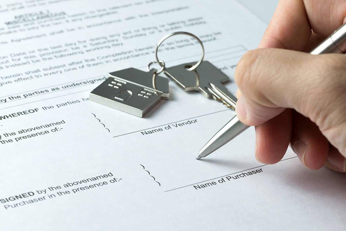 Man signing sale and purchase agreement at purchaser column